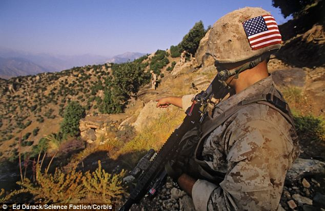Lookout: A U.S. Marine searches for signs of Al Qaeda and Taliban activity  in the foothills of the Hindu Kush in eastern Afghanistan
