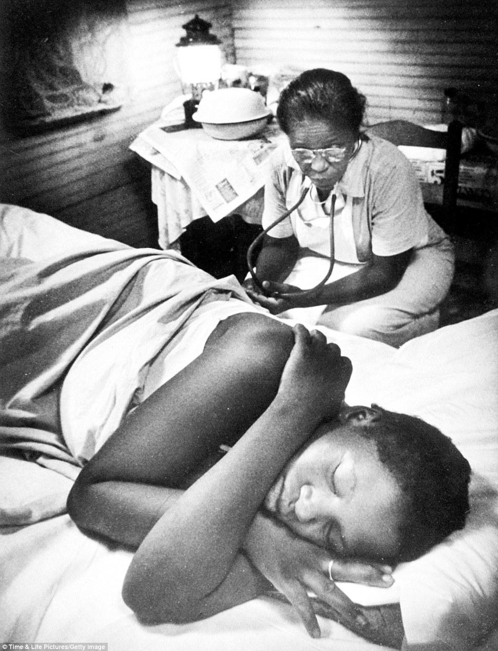 Safe under her watchful eye: Maude Callen attends to a woman in labor