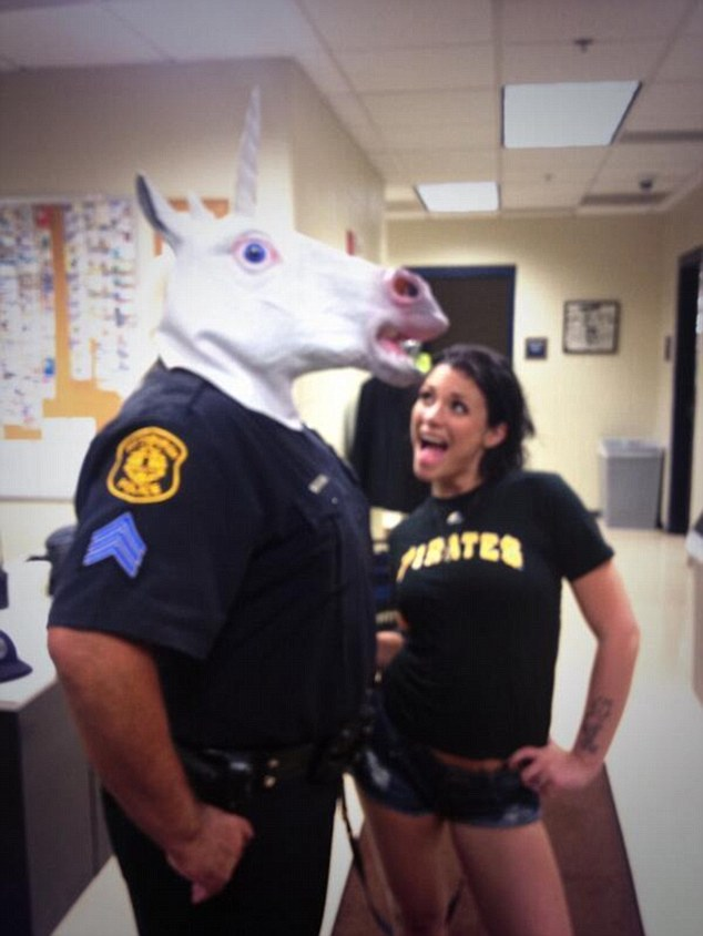 Uni-trouble: A Pittsburgh police officer landed himself in hot water when he was photographed 'unicorning' with porn star Andy San Dimas
