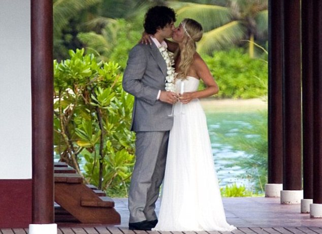 In happier times: The pair wed in a romantic ceremony in the Seychelles in 2009