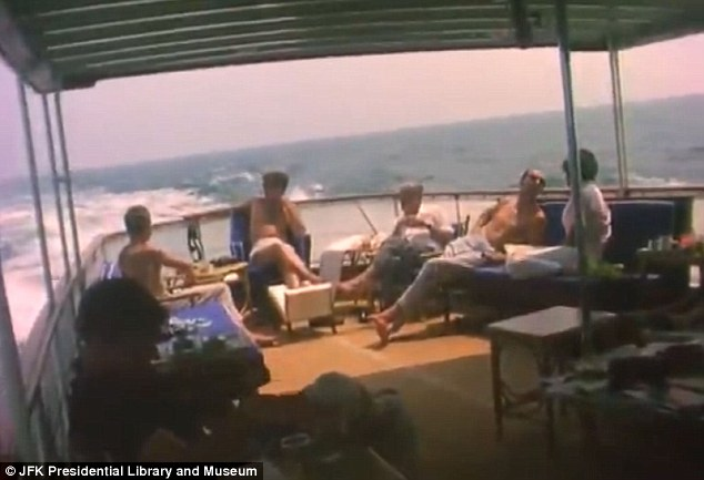 On board: The First Family and their friends enjoy the boat trip off the coast near the Kennedy Compound
