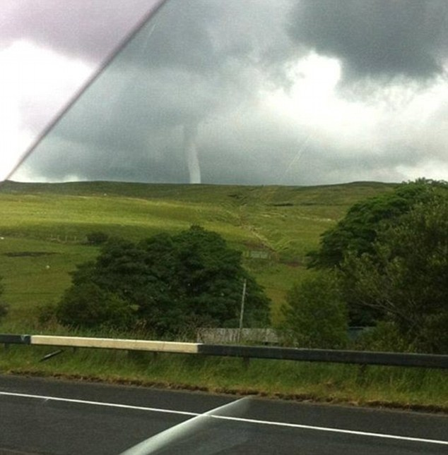 Blown away: A driver captures a tornado ripping through Glenshane Pass in Northern Ireland