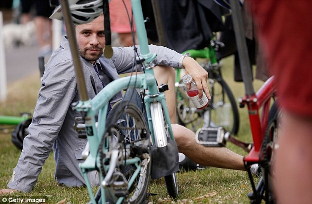 A competitor cools down after the Brompton World Championship folding bike race at Goodwood Motor Circuit in Chichester