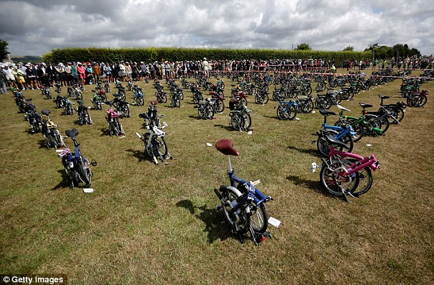 Bikes are lined up as a horn signals the start of the Brompton World Championship folding bike race, which is part of the Orbital cycling festival at Goodwood Motor Circuit