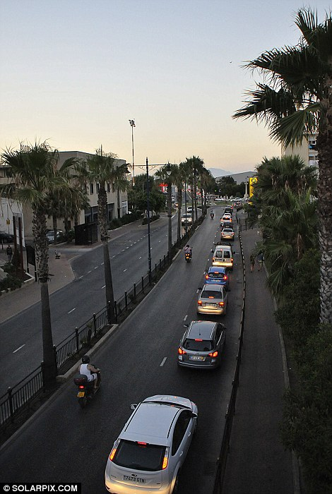 Spanish police stopped every one of 10,000 vehicles leaving Gibraltar for the mainland yesterday
