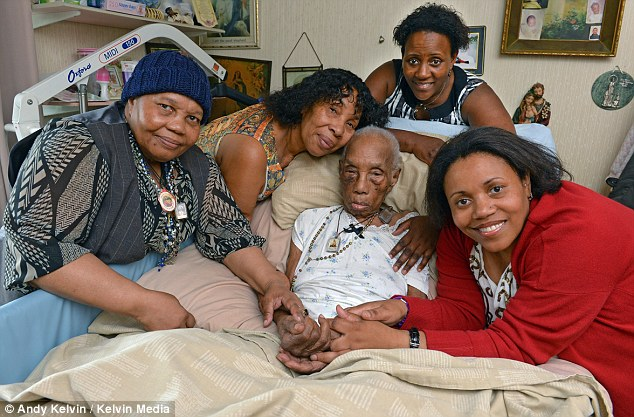 The family of 107-year-old Minetta Webb (centre) say they were accused of abducting her from Manchester Royal Infirmary. Pictured are daughters Rosemary, 76 and Angela, 68, with grand-daughters Susan, 50 and D'borah, 53.