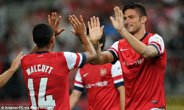 Growing partnership: Theo Walcott and Giroud could be key for Arsenal if they don't sign a striker