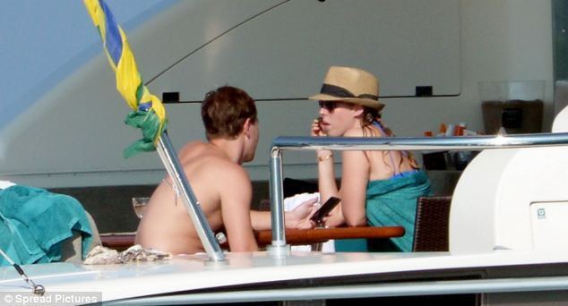 The princess and her boyfriend looked deep in conversation while sitting together on board their luxury yacht