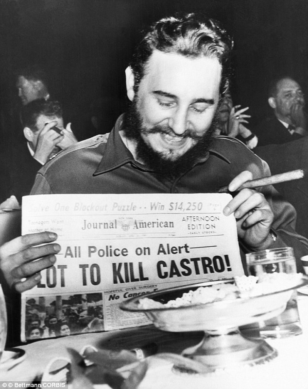 Dictator: Seeming quite amused, Castro holds up a newspaper headlining the discovery of a plot to kill him in 1959