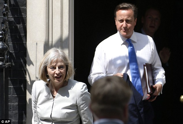 Colleagues: Home Secretary Theresa May is pictured with Prime Minister David Cameron earlier this month. Mrs May will want to be independent, yet everyone must be aware of the signs and symptoms of her condition