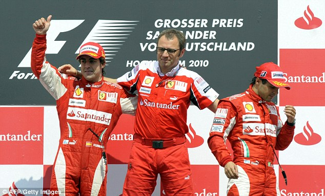 Teamwork: Domenciali (centre) with Alonso (left) after the Spaniard won the German Grand Prix in 2010