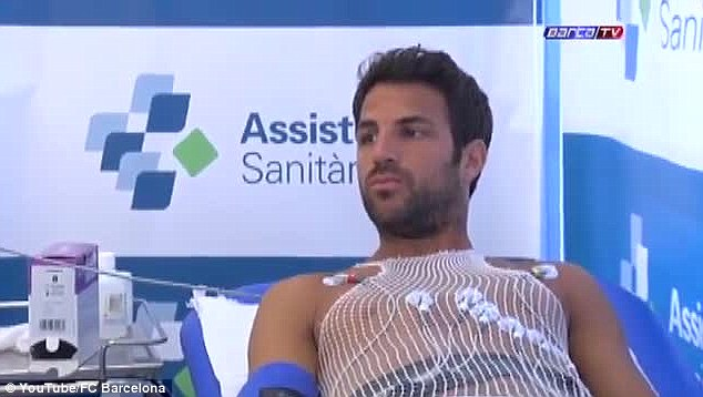On the table: Cesc Fabregas had his pre-season medical on returning to Barcelona ahead of the new campaign