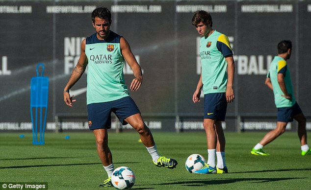 Good to be back: Fabregas looked perfectly relaxed as he went through some simple ball drills