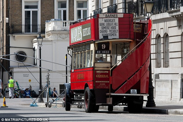 Iconic: A traditional red London bus was seen on set as the cast and crew invaded the capital for the day