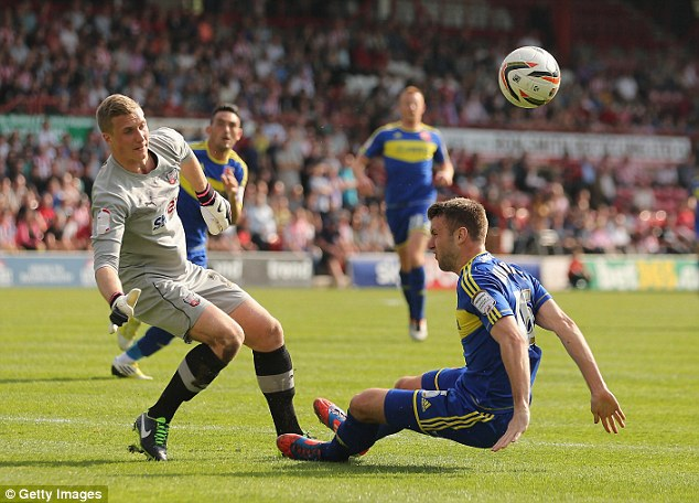 On the move: Goalkeeper Simon Moore (left) has completed his switch from Brentford to Cardiff