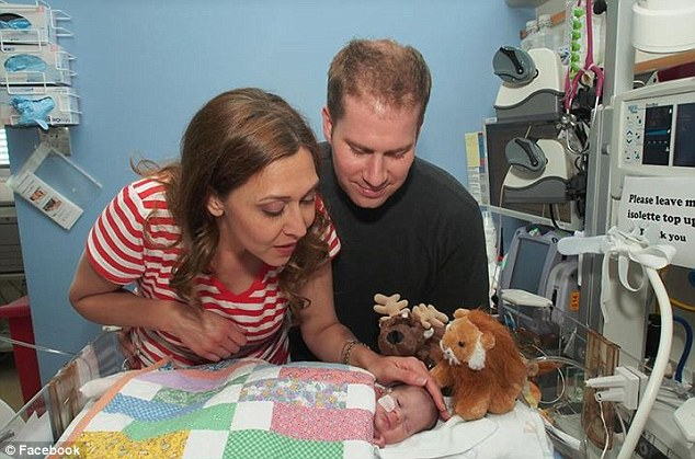 Miracle baby: The Beutlers with their tiny newborn Abigail when she was just two weeks old