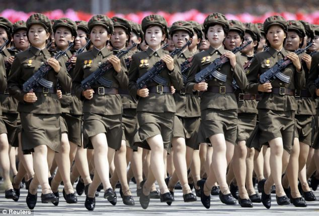 Each of the women has their hair cut to the same prescribed length, while the mini-skirted uniform is completed with short socks over flesh-coloured tights