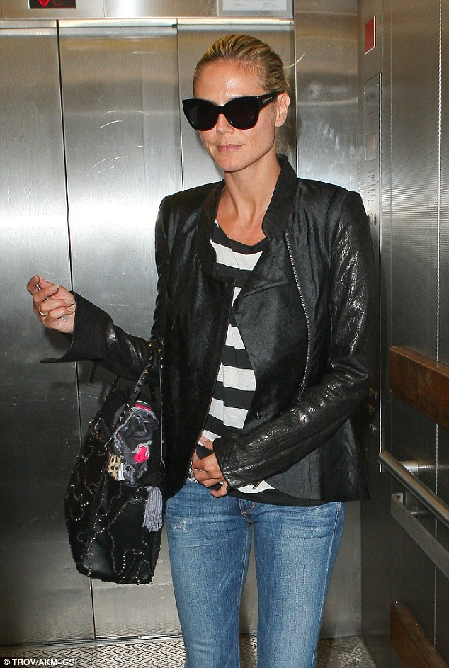 Bicoastal beauty: Heidi Klum arrived at LAX on Monday for her flight to New York, where she is currently filming America's Got Talent