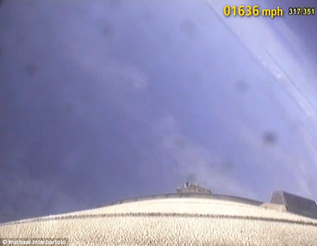Plummet: The camera catches the descent right down the length of the plummeting rocket booster. Things go from black to blue as it nears the atmosphere once again