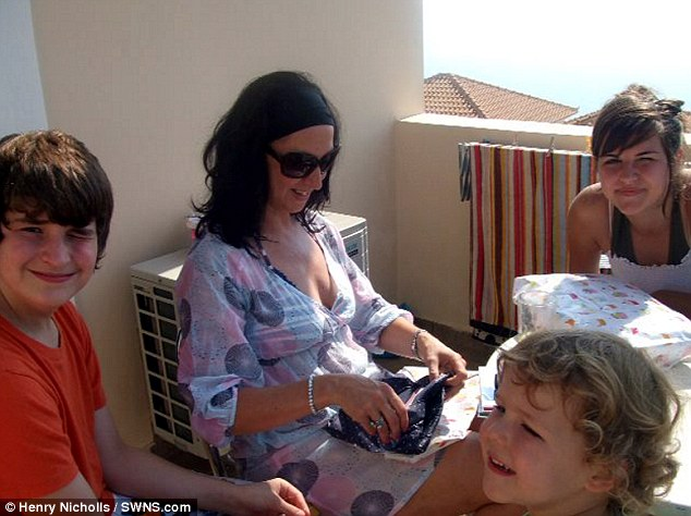 Family: The mother-of-three became engulfed in flames after a tea-light set her dress alight