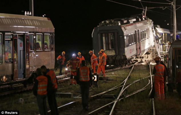 The two trains collided head-on in Switzerland, injuring about 35 people, five seriously, police said