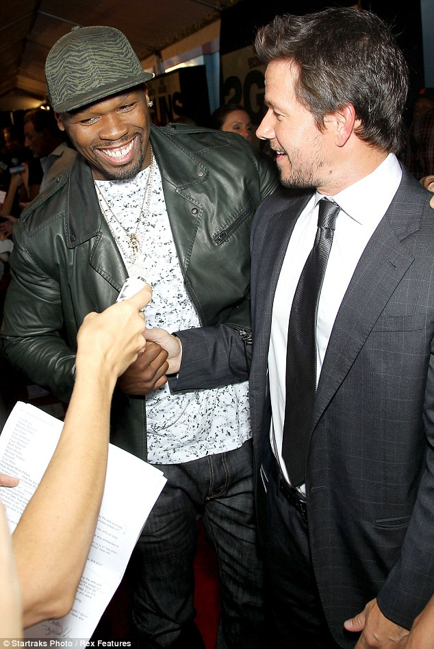 Finally some alone time: Mark and 50 Cent clasp hands and bond amid the clamor of the red carpet
