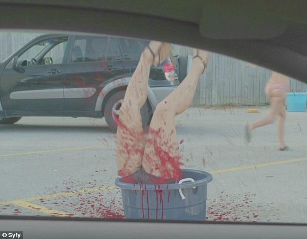 Blood bath: A car washing bikini clad girl is swallowed by a bucket filled with the shark's spirit