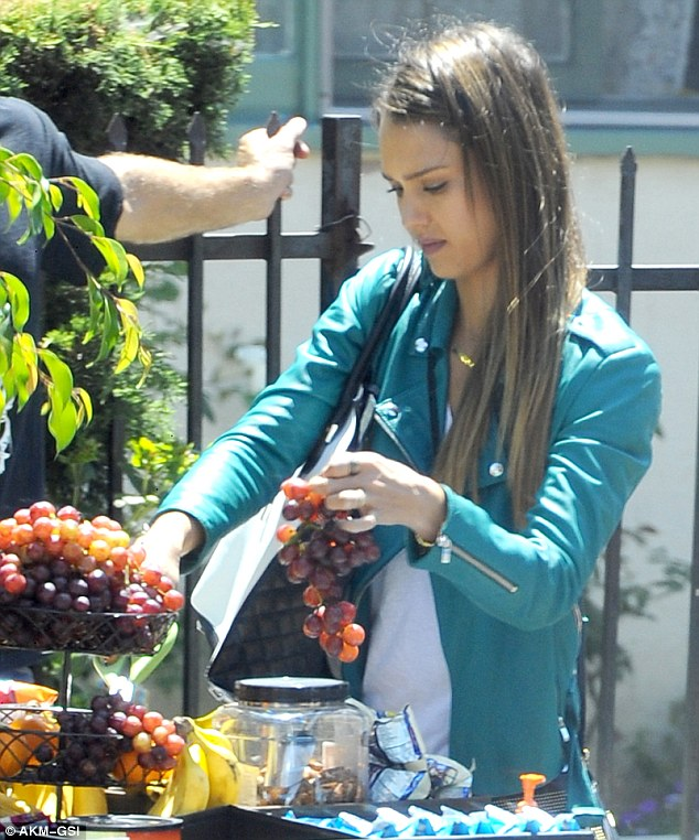 Good choice! Jessica was seen handling a rather large bunch of grapes