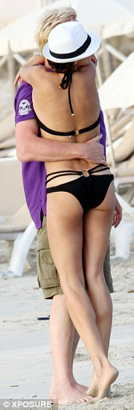 Hands on: Boris struggled to keep his hands off his stunning wife