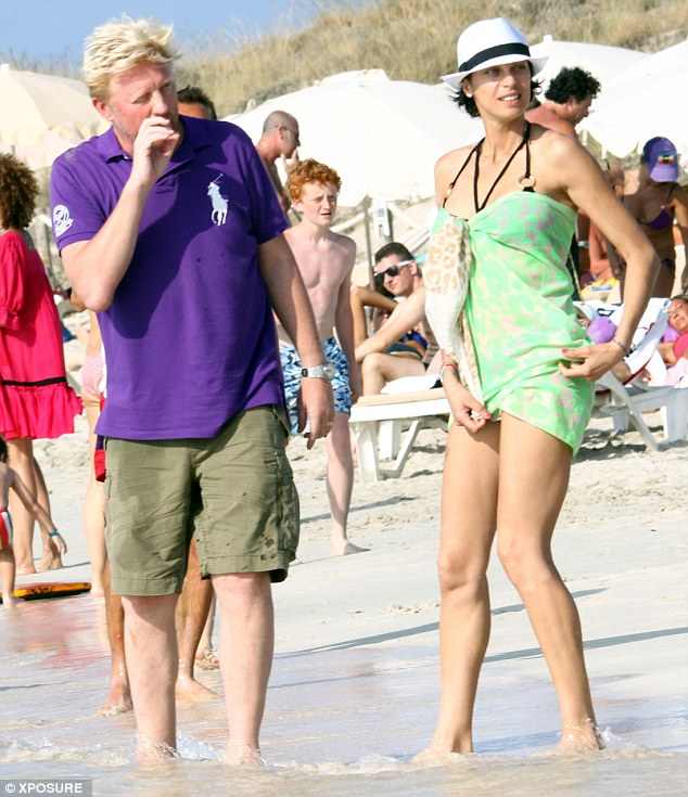 Fun in the sun: Lilly later wore a mint green sarong tied over the bikini