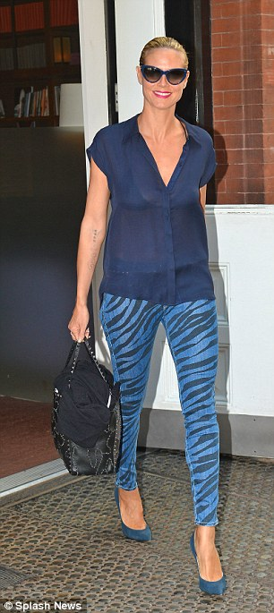 Tiger stripes: Heidi wore some fancy pants as she left her hotel