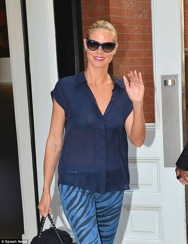 Looking sharp: Heidi Klum wore an all blue outfit as she left her New York City Hotel on Tuesday