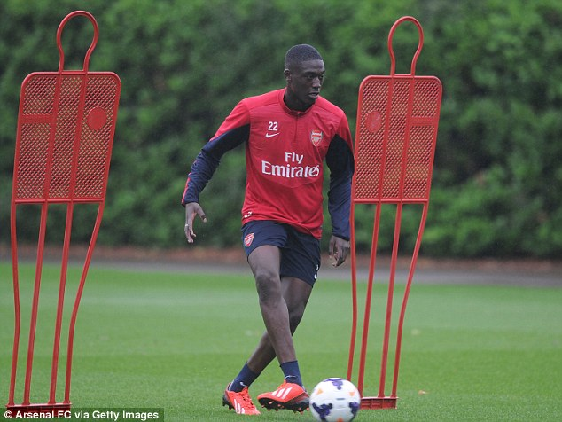 Welcome aboard: Yaya Sanogo has been put through his first training session with new club Arsenal