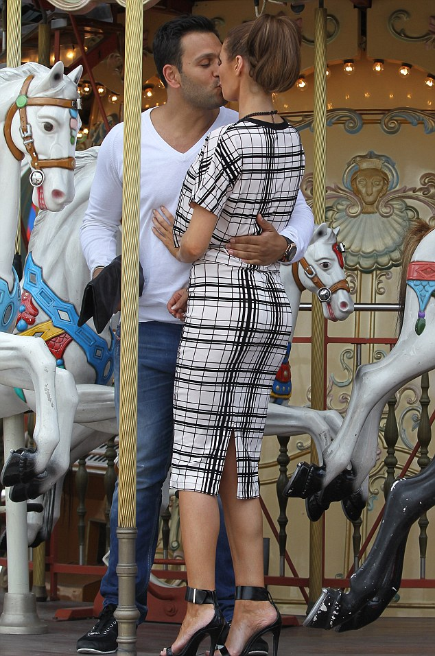 Another kiss: Clearly besotted, Joe pulled Chloe in for yet another smooch after the ride