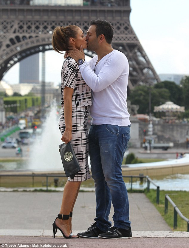 Pucker up: The TOWIE star and her new man shared a passionate kiss in the City of Lights