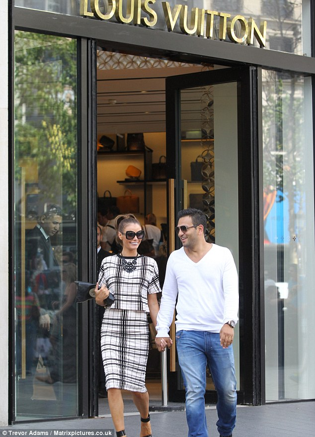 Treating her: The couple stopped by a number of designer stores during the trip as Chloe picked up some things
