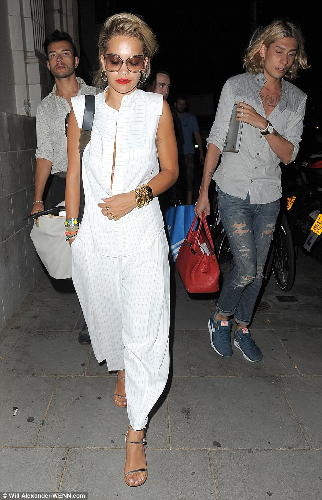 From smart to causal: Rita paired her trousers with a matching top for her dinner out in Notting Hill