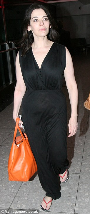 Nigella Lawson was seen at Heathrow airport last night before the decree nisi was granted today