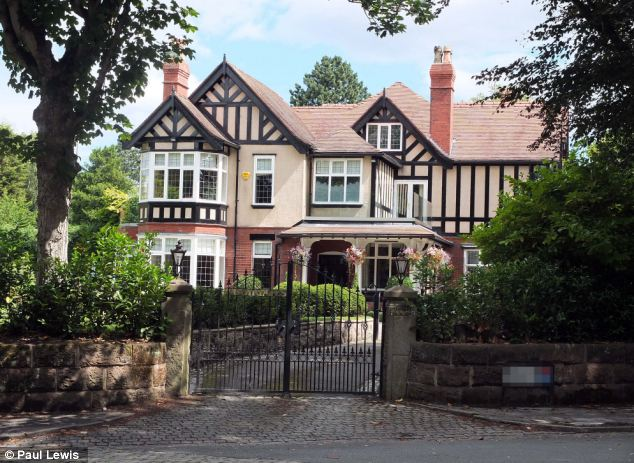 Family home: The £1.2m property in Hale, Greater Manchester, where Rawlings lives with his mother and accountant father Martin
