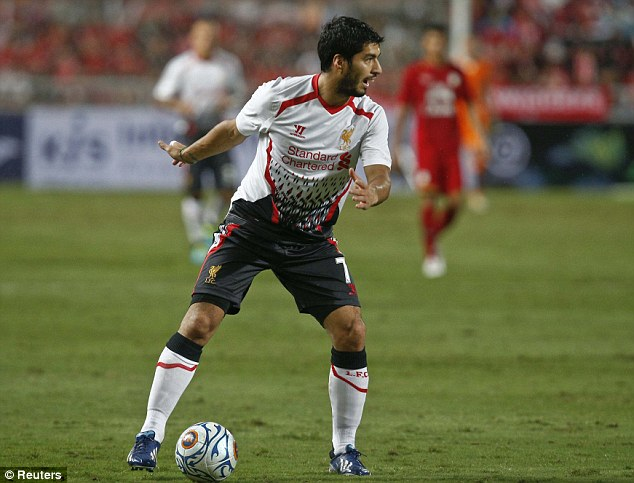 On the ball: Suarez featured for Liverpool against Thailand in Bangkok