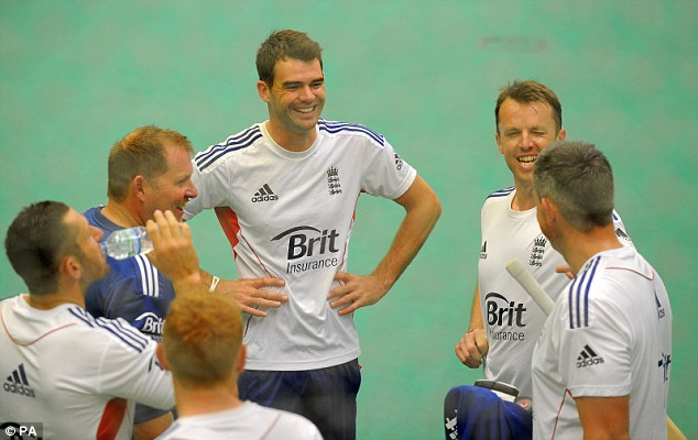 Time to get serious: James Anderson and Graeme Swann are told a joke by one-day coach Ashley Gilles