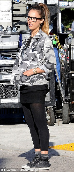Retro: The star's outfit featured a camouflage jacket, lion T-shirt, mini skirt and leggings