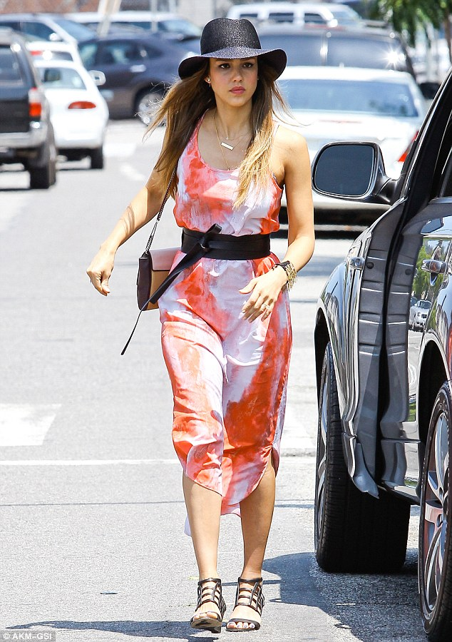 To dye for: Jessica looked pretty in a coral tie dye dress during a Beverly Hills shopping spree on June 29