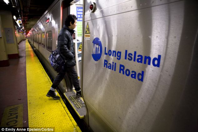 Leap: They threw themselves in front of a Long Island Rail Road train (file picture) as it traveled 80 mph