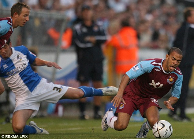 Hammer blow: The midfielder (right) had an injury-hit spell at West Ham