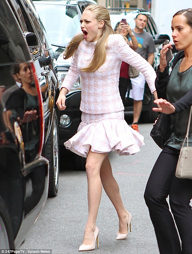 Ouch! Amanda Seyfried twists her ankle as she arrives at the Late Show With David Letterman in New York