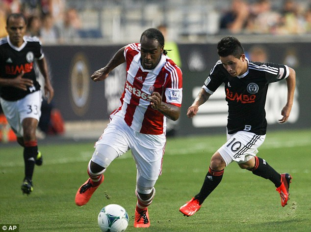 In action: Cameron Jerome gets past Philadelphia Union's Roger Torres during the first half