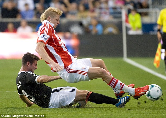 Scythed down: Brek Shea suffered a knee injury thanks to a rash challenge from Philadelphia's Matt Kassel