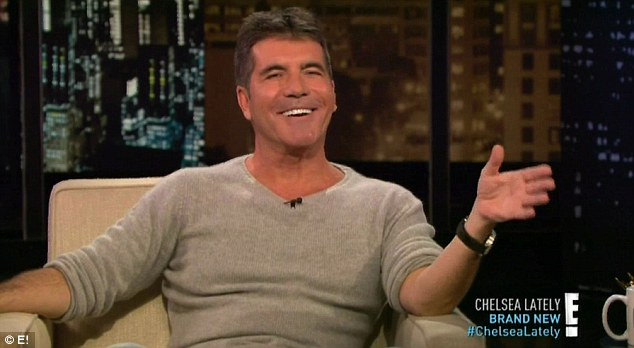 Opening up: Simon Cowell admitted that he prefers smoking to sex during an interview on Chelsea Lately on Tuesday night