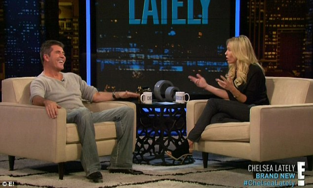 Giggles all round: Host Chelsea Handler certainly appeared to be keeping Cowell entertained during the interview